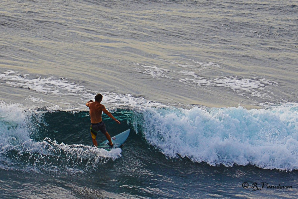 Surfing at Uluwatu, Bali, Indonesia NIKON D5100, f/7.1, 1/800, ISO 200, 300mm